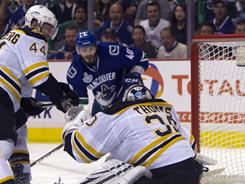 Vancouver Canucks right wing Maxim Lapierre scores on Boston Bruins goalie Tim Thomas for the lone goal of the game.