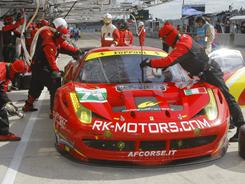 The Ferrari 458 Italia driven by Robert Kauffman, Michael Waltrip and Ruis Aguas makes a pit stop during the 79th 24 Hours of Le Mans.