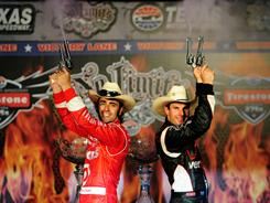 Will Power (right) and Dario Franchitti celebrate in victory lane at Texas Motor Speedway after splitting wins in the Firestone Twin 275s.