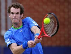 Andy Murray of Great Britain plays a backhand  during his semifinal match against Andy Roddick of the U.S. at the Aegon championships, in London, on Saturday. Murray won 6-3, 6-1.