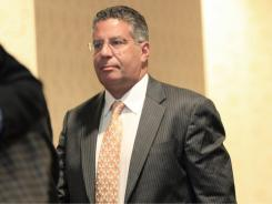 Former Tennessee basketball coach Bruce Pearl leaves a hearing by the NCAA's infractions committee in Indianapolis, Saturday. The NCAA has charged the university with recruiting violations.