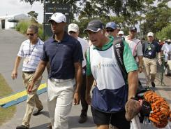Tiger Woods' caddie Steve Williams, right,  seen here leaving The Players Championship in May, was seen working with Adam Scott at Congressional,  the site of the U.S. Open, on Saturday a USGA official said.