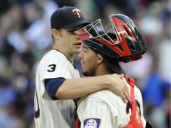Twins pitcher Scott Baker, left, and catcher Rene Rivera celebrate Baker's fourth career complete game, an 8-1 win over the Rangers.