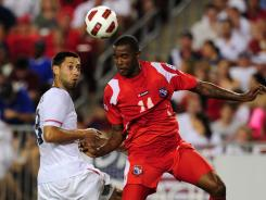 Clint Dempsey, left, of the USA and Eduardo Dasent of Panama fight for the ball during their Gold Cup match in Tampa