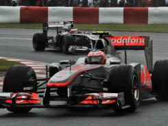 Jenson Button leads Rubens en route to winning the Canadian Grand Prix at the Circuit Gilles Villeneuve in Montreal.