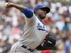 Dodgers starter Rubby De La Rosa threw five effective innings in his second career start before exiting with arm cramps.