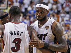 The Heat's LeBron James hugs teammate Dwyane Wade after Miami fell to the Dallas Mavericks in Game 6 of the NBA Finals.