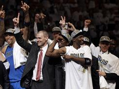 Dallas Mavericks head coach Rick Carlisle and his team celebrate after beating the Miami Heat 105-95 in Game 6 to capture their first NBA title.