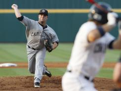 South Carolina pitcher Colby Holmes delivers in the first inning against Connecticut in Game 2 of their Super Regional series in Columbia, S.C.