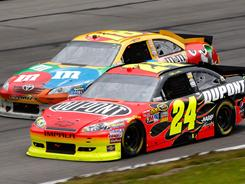 NASCAR docked Kyle Busch and Joe Gibbs Racing 6 points after Busch's No. 18 Toyota (shown racing Sunday with Jeff Gordon's winning Chevrolet) was ruled too low in the left front after finishing third at Pocono Raceway.