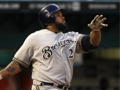 Brewers' Prince Fielder watches after hitting a solo home run against the Marlins.