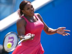 Serena Williams of the USA fires a forehand during her victory Tuesday against to Tsvetana Pironkova of Bulgaria at the Aegon Interrnational in Eastbourne, England. It was Williams' first match in nearly a year.
