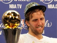 "Hailed by the German media, NBA Finals MVP Dirk Nowitzki became ""an indisputable global sports star as popular in America and internationally as he is at home."""