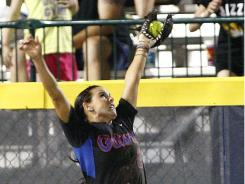 Florida left fielder Kelsey Bruder makes a leaping catch against Arizona State in this year's Women's College World Series.