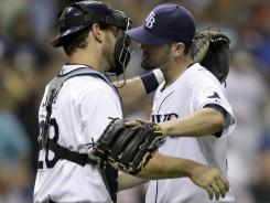 Rays starting pitcher James Shields, right, hugs catcher John Jaso after Shields completed his AL-best third complete game of the season.