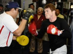 Mexico's Saul Alvarez trained for his title defense in California, which helped him escape the distractions of home.