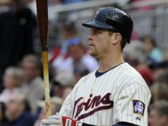 The Twins put Justin Morneau on the disabled list Tuesday for a strained left wrist.