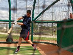 Minnesota Twins' Joe Mauer takes batting practice while working out with the Fort Myers Miracle minor league baseball team on Wednesday. Mauer has been on the disabled list since April 12 with  bilateral leg weakness and soreness in his throwing shoulder