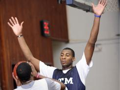Andre Drummond, right, has drawn the attention of several top college programs, including defending national champ Connecticut.