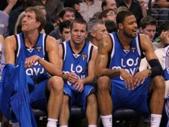 Mavericks forward Dirk Nowitzki, left, guard Jose Juan Barea, center, and center Tyson Chandler helped Dallas win its first NBA title.