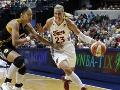 The Fever's Katie Douglas, driving past the Shock's Jennifer Lacy, scored 22 points, shooting 8-for-13 from the field and  6-for-9 from behind the arc in Indiana's 82-74 win.