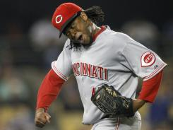 Reds starting pitcher Johnny Cueto celebrates the final out of the seventh inning against the Dodgers. It was Cueto's 100th career start.