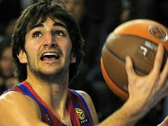 Barcelona's Ricky Rubio, right, vies with Cholet's Vule Avdalovic during their Euroleague match last December at the Palau Blaugrana hall in Barcelona.