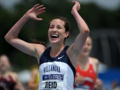 Sheila Reid celebrates her victory June 11 in the 1,500 meters at the NCAA outdoor championships in Des Moines.