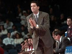In this 1995 file photo, University of Massachusetts coach John Calipari leads his team against Florida.