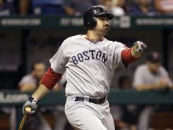Adrian Gonzalez watches his ninth-inning homer leave Tropicana Field in Boston's 11th win in 12 games.