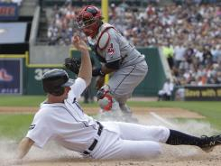 Tigers' Don Kelly drives in a run on two hits against the Indians.