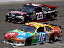 Kyle Busch (18) races Kevin Harvick (29) during the NASCAR Sprint Cup Series STP 400 at Kansas Speedway on June 5.
