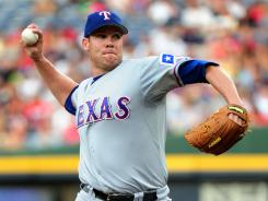 Colby Lewis was coming off a pair of ugly starts, but bounced back in a big way Friday for the Rangers.