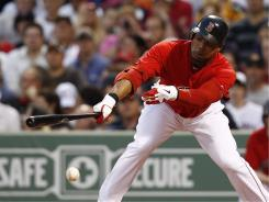 Red Sox outfielder Carl Crawford left Friday's game against the Brewers in the first inning.
