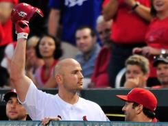 Matt Holliday salutes the St. Louis crowd fans after hitting a game-winning two-run home run against the Royals at Busch Stadium Saturday. The Cardinals ended a seven-game losing streak with a 5-4 win over the Royals.