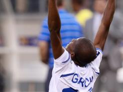 Honduras midfielder Oscar Boniek Garcia celebrates after his team defeated Costa Rica in a shootout during a CONCACAF Gold Cup tournament quarterfinal soccer game at the New Meadowlands Stadium  Saturday.