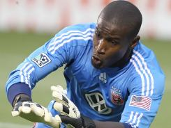 DC United goalkeeper Bill Hamid dives for a ball during a game against Real Salt Lake in Sandy on Saturday. The match ended in a 1-1 tie.
