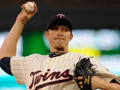 Twins starter Scott Baker tossed eight innings of 10-strikeout baseball Saturday night, combining with closer Matt Capps to blank the Padres, 1-0, in Minnesota.
