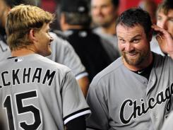 White Sox pitcher John Danks, right, jokes with teammate Gordon Beckham after being hit by a batted ball during the fourth inning against the Diamondbacks in Phoenix. The White Sox won 6-2.