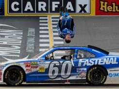 Carl Edwards celebrates his fourth Nationwide Series win of the season with his customary backflip.