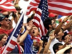 United States fans celebrate after the U.S. team defeated Jamaica, 2-0, in the CONCACAF Gold Cup quarterfinal match Sunday at RFK Stadium. The U.S. will face the Panama-El Salvador winner Wednesday.
