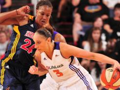 Diana Taurasi, right, driving past the Fever's Tamika Catchings, scored a game-high 32 points to lift the Mercury to their first win.