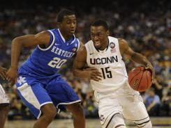 Kemba Walker, driving past Kentucky guard Doron Lamb,  was indefatigable in lifting Connecticut to Big East and NCAA titles in March and April.
