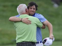 Rory McIlroy shares a hug with his father Gerry after winning the 111th U.S. Open.