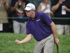 Robert Garrigus makes a par on 18 to finish at 6 under, sharing honors for top American and tying for third overall.