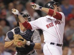 Adrian Gonzalez, right, connects for a one-run double during his 3-RBI seventh inning, when the Red Sox scored 10 runs