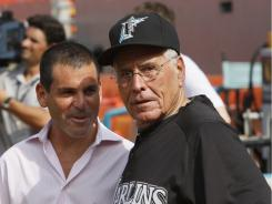 Marlins' president David Samson, left, and Jack McKeon talk before a game against the Angels.
