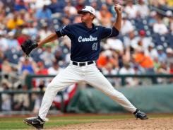 North Carolina pitcher Kent Emanuel delivers during his complete-game shutout victory vs. Texas in Omaha.