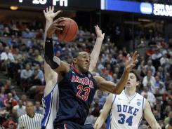 Arizona forward Derrick Williams (23), grabbing a rebound against Duke, can play with his back to the basket or shoot from outside.
