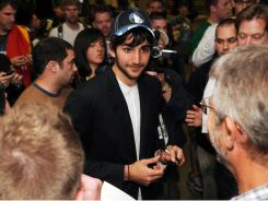 Spanish point guard Ricky Rubio signs autographs after arriving at the Minneapolis-St. Paul airport on Monday.